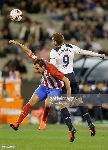 Diego Godn of Atletico Madrid and Vincent Janssen of Tottenham Hotspur compete for the ball during 2016 International Champions Cup Australia match...