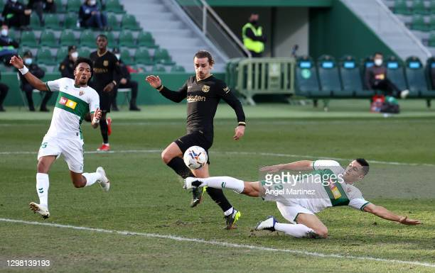 Diego Gonzales of Elche CF passes the ball back to Frenkie de Jong of Barcelona to score his side's first goal during the La Liga Santander match...
