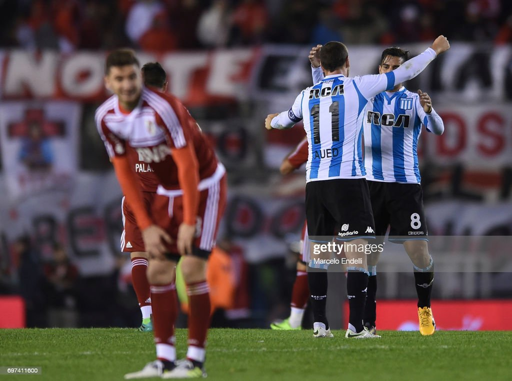 Diego Gonzalez and Luciano Aued of Racing Club celebrate after winning a match between River Plate and Racing Club as part of Torneo Primera Division 2016/17 at Monumental Stadium on June 18, 2017 in Buenos Aires, Argentina.