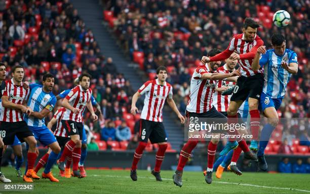 Diego Gonzalez of Malaga CF competes for the ball with Aritz Aduriz of Athletic Club during the La Liga match between Athletic Club Bilbao and Malaga...