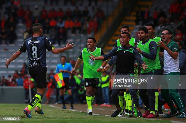 Diego Gonzalez of Santos Laguna celebrates with his teammates after scoring the tying goal during a match between Toluca and Santos Laguna as part of...