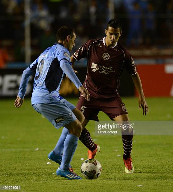 Diego González of Lanús struggles for the ball with Juan Sánchez Capdevila of Bolívar during a second leg quarter final match between Bol'ívar and...