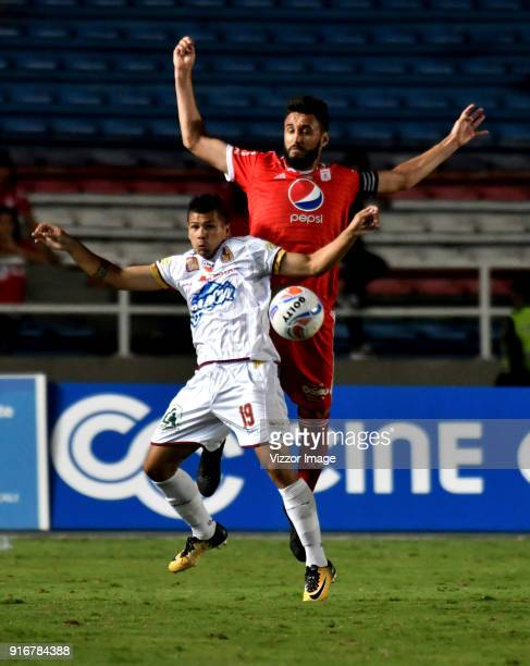 Diego Herner of of America vies for the ball with Robin Ramirez of Deportes Tolima during a match between America de Cali and Deportes Tolima as part...