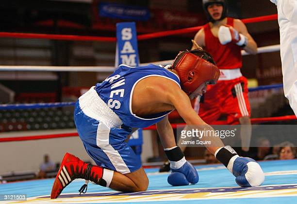 Diego Hurtado is knocked to the ground by Robert Castillo during the United States Olympic Team Boxing Trials at Battle Arena on February 19 2004 in...