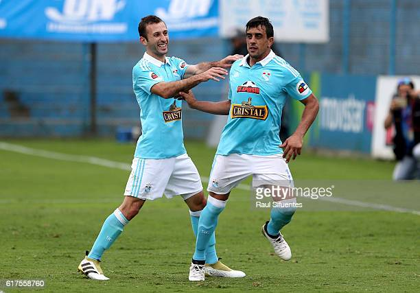 Diego Ifran of Sporting Cristal celebrates with teammate after scoring the third goal of his team during a match between Sporting Cristal and Cesar...