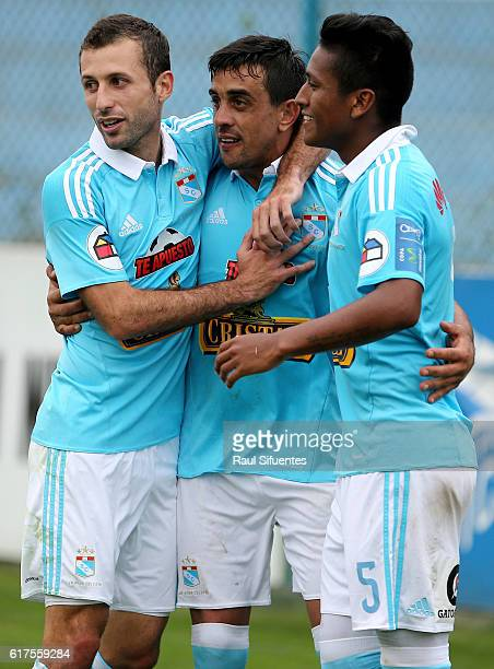 Diego Ifran of Sporting Cristal celebrates with teammates after scoring the third goal of his team during a match between Sporting Cristal and Cesar...