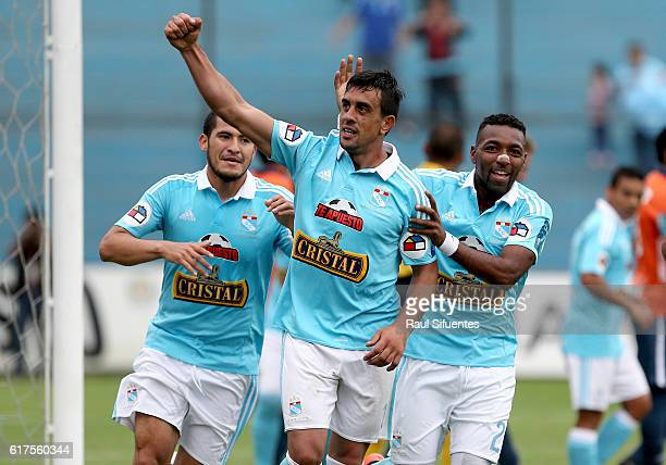 Diego Ifran of Sporting Cristal celebrates with teammates after scoring the fifth goal of his team during a match between Sporting Cristal and Cesar...