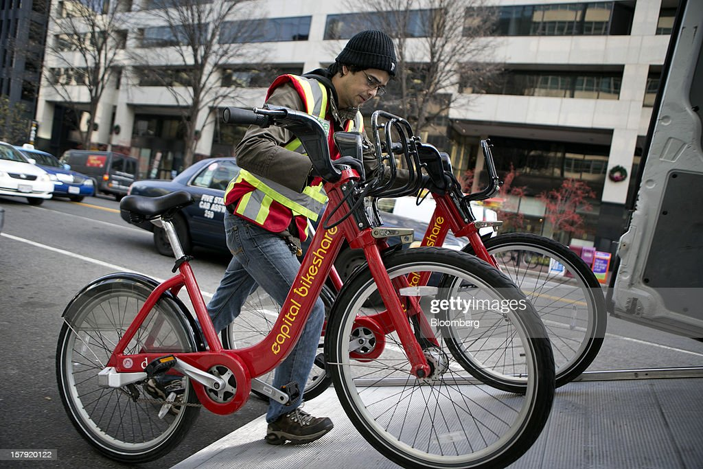 Diego Jaramillo loads Capital Bikeshare bicycles into the 'sprinter' van in Washington, D.C., U.S., on Friday, Nov. 30, 2012. Since Sept. 2010, Capital Bikeshare has dispersed more than 1700 bikes for rent across the city and has totaled over 3.5 million rides since Sept. 2011. Alta Bicycle Share, the company that was awarded the contract to run the program, has installed 191 solar-powered docking stations throughout the District and Arlington, Virginia. Photographer: Andrew Harrer/Bloomberg via Getty Images