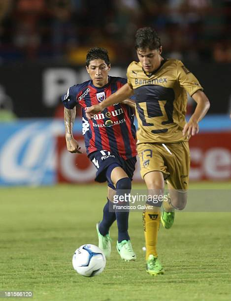 Diego Jimenez of Atlante and Jose Carlos Van Rankin of Pumas dispute the ball during a match between Atlante and Pumas UNAM as part of the Apertura...