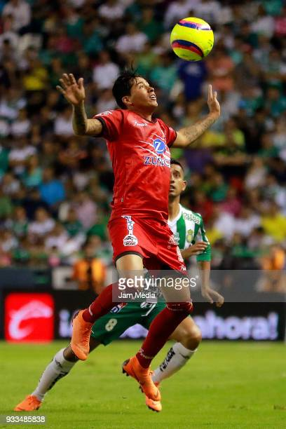 Diego Jimenez of Lobos BUAP and Elias Hernandez of Leon competesfor the ball during the 12th round match between Leon and Lobos BUAP as part of the...