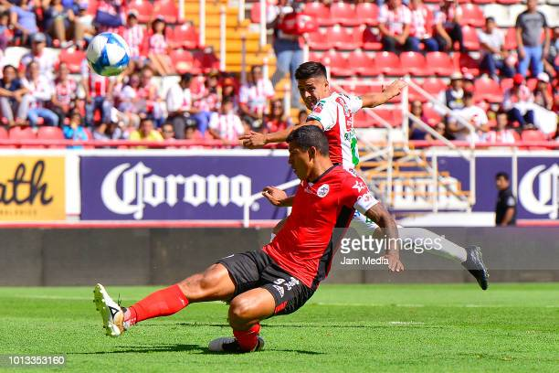 Diego Jimenez of Lobos BUAP fights for the ball with Facundo Castro of Necaxa during the third round match between Necaxa and Lobos BUAP as part of...