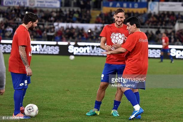 Diego Junior Francesco Totti and Diego Armando Maradona participate the charity football match at Stadio Olimpico in Rome Italy on October 12 2016