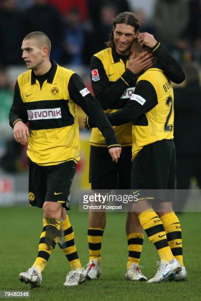 Diego Klimowicz celebrates the 33 with Delorn Buckley after the Bundesliga match between MSV Duisburg and Borussia Dortmund at the MSV Arena on...