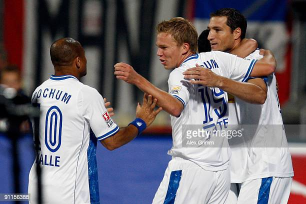 Diego Klimowicz of Bochum celebrates his team's first goal with team mates Dennis Grote and Joel Epalle during the Bundesliga match between 1 FC...