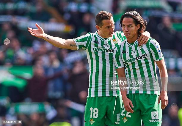 Diego Lainez and Andres Guardado of Real Betis celebrate after victory during the La Liga match between Real Betis Balompie and Girona FC at Estadio...