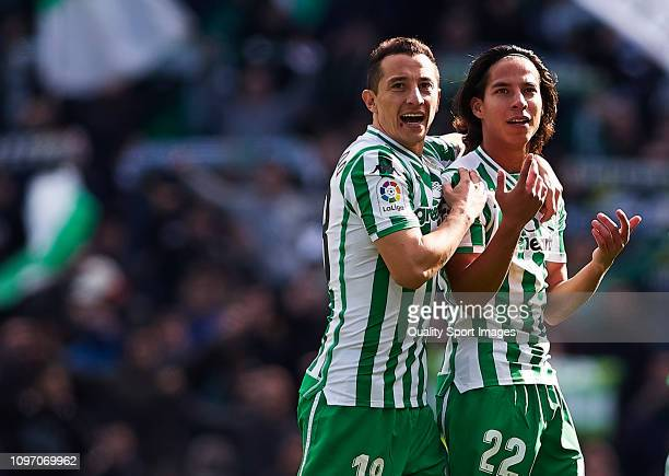 Diego Lainez and Andres Guardado of Real Betis celebrate the victory after the La Liga match between Real Betis Balompie and Girona FC at Estadio...