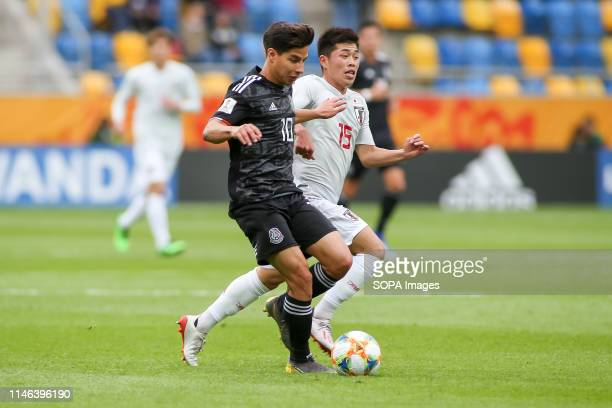 Diego Lainez from Mexico and Toichi Suzuki from Japan are seen in action during the FIFA U20 World Cup match between Mexico and Japan in Gdynia