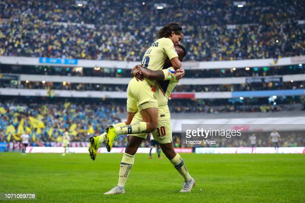 Diego Lainez of America celebrate with teammates after scoring the 5th goal of his team during the semifinal second leg match between America and...