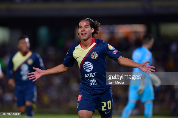 Diego Lainez of America celebrates after scoring the first goal of his team during the semifinal first leg match between Pumas UNAM and America as...