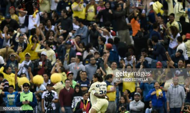 Diego Lainez of America celebrates his goal against Pumas with his teammate Renato Ibarra during the second round of semifinals of the Mexican...