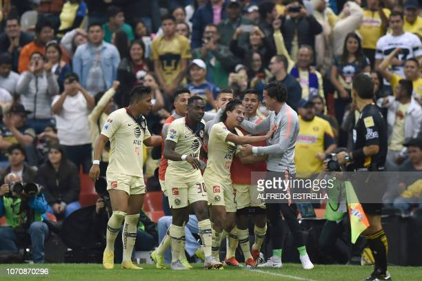 Diego Lainez of America celebrates his goal against Pumas with his teammates during the second round of semifinals of the Mexican Apertura tournament...