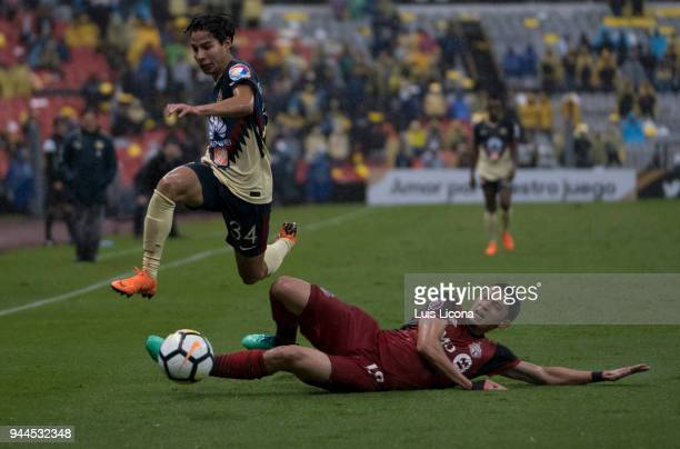 Diego Lainez of America dribbles Marky Delgado of Toronto during the semifinal second leg match between America and Toronto at Azteca Stadium on...