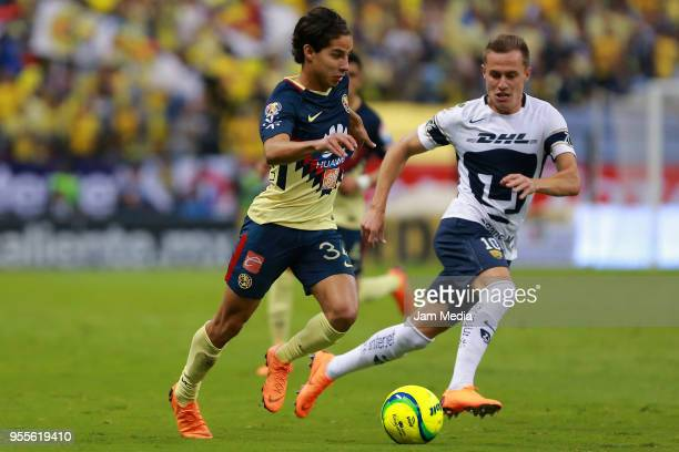 Diego Lainez of America fights for the ball with Abraham Gonzalez of Pumas during the quarter finals second leg match between America and Pumas UNAM...