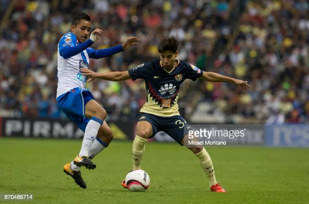Diego Lainez of America fights for the ball with Alonso Zamora of Puebla during the 16th round match between America and Puebla as part of the Torneo...