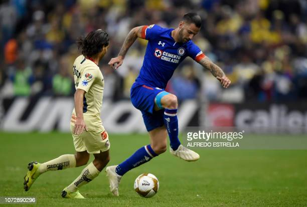 Diego Lainez of America vies for the ball with Martin Cauteruccio of Cruz Azul during the first round match of the final of the Mexican Apertura...