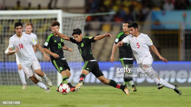 Diego Lainez of Mexico is challenged by Majid Nasiri of Iran during the FIFA U17 World Cup India 2017 Round of 16 match between Iran and Mexico at...