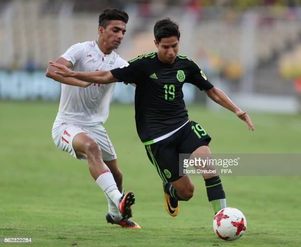 Diego Lainez of Mexico is challenged by Younes Delfi of Iran during the FIFA U17 World Cup India 2017 Round of 16 match between Iran and Mexico at...