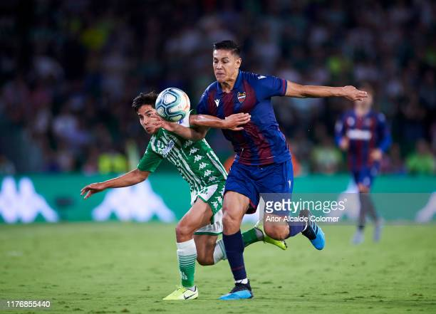 Diego Lainez of Real Betis Balompie duels for the ball with Oscar Duarte of Levante UD during the Liga match between Real Betis Balompie and Levante...
