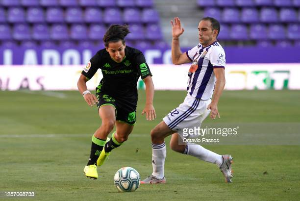 Diego Lainez of Real Betis battles for possession with Nacho Martinez of Real Valladolid during the Liga match between Real Valladolid CF and Real...