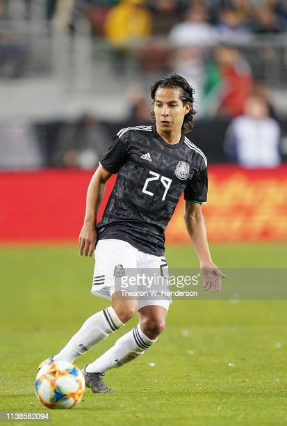 Diego Lainez of the Mexico National team dribbles the ball up field against Paraguay during the first half of their soccer game at Levi's Stadium on...