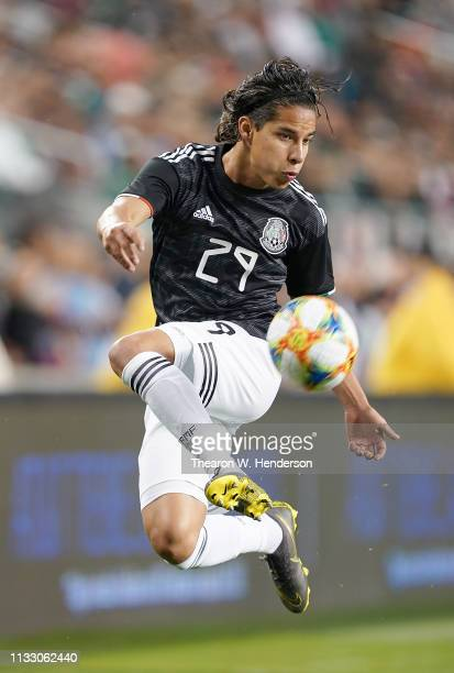 Diego Lainez of the Mexico National team leaps in the air attempting to gain control of the ball against Paraguay during the first half of their...