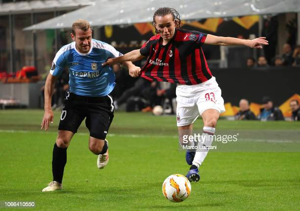 Diego Laxalt of AC Milan competes for the ball with Dominik Stolz of F91 Dudelange during the UEFA Europa League Group F match between AC Milan and...