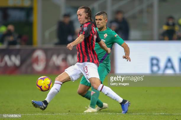 Diego Laxalt of AC Milan competes for the ball with Vincent Laurini of ACF Fiorentina during the Serie A match between AC Milan and ACF Fiorentina at...