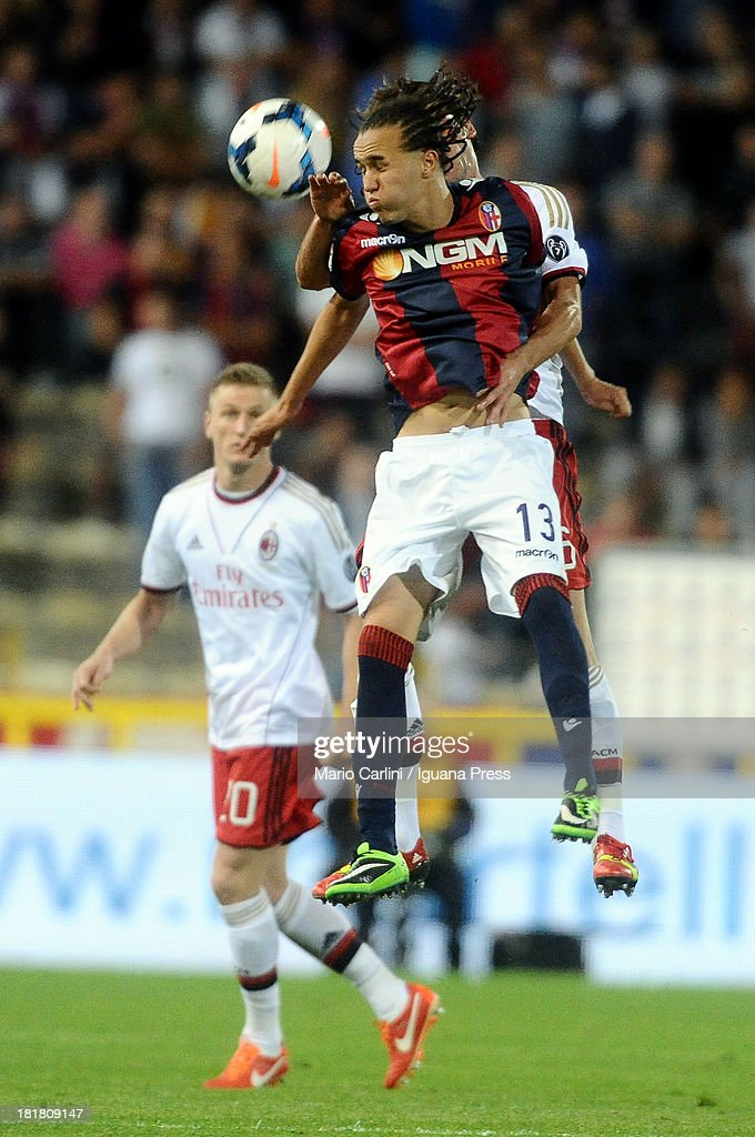 Diego Laxalt # 13 of Bologna FC heads the ball during the Serie A match between Bologna and AC Milan at Stadio Renato Dall'Ara on September 25, 2013 in Bologna, Italy.