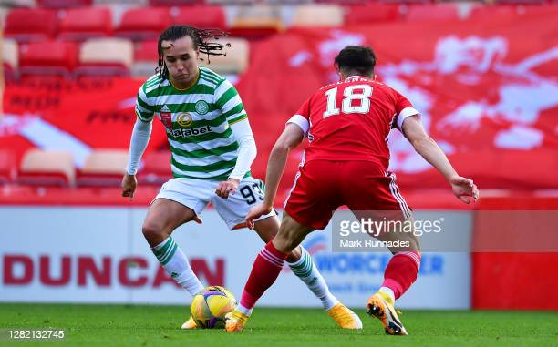 Diego Laxalt of Celtic takes on Connor McLennan of Aberdeen during the Ladbrokes Scottish Premiership match between Aberdeen and Celtic at Pittodrie...
