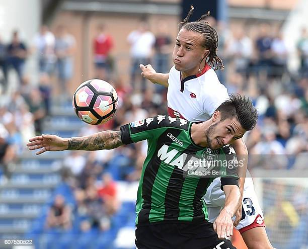 Diego Laxalt of Genoa CFC and Matteo Politano of US Sassuolo in action during the Serie A match between US Sassuolo and Genoa CFC at Mapei Stadium...