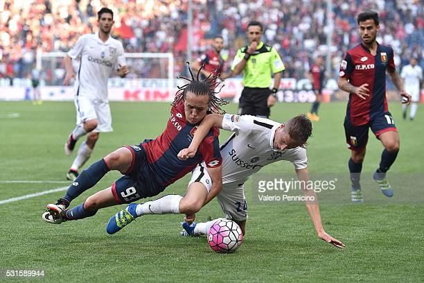 Diego Laxalt of Genoa CFC is tackled by Andrea Conti of Atalanta BC during the Serie A match between Genoa CFC and Atalanta BC at Stadio Luigi...