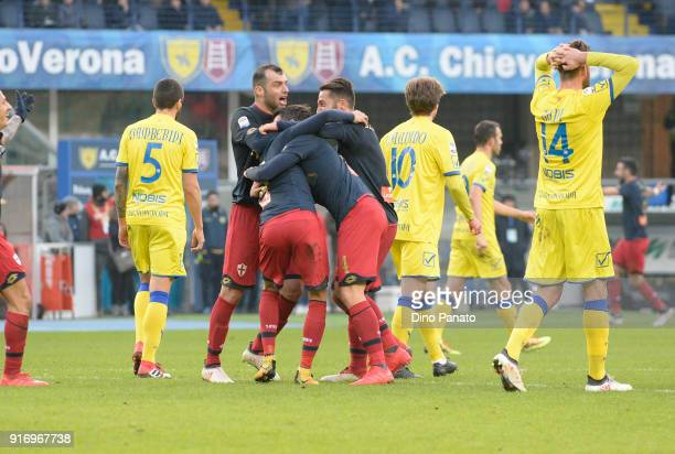 Diego Laxalt of Genoa is mobbed by team mates after scoring his team's opening goal during the serie A match between AC Chievo Verona and Genoa CFC...