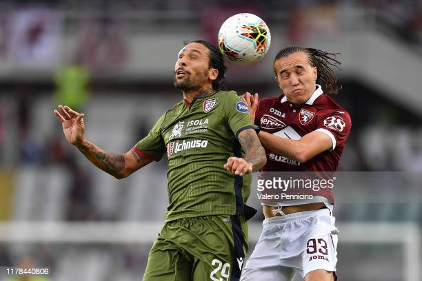 Diego Laxalt of Torino FC clashes with Lucas Castro of Cagliari Calcio during the Serie A match between Torino FC and Cagliari Calcio at Stadio...
