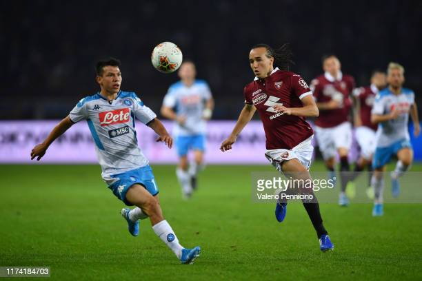 Diego Laxalt of Torino FC in action against Hirving Lozano of SSC Napoli during the Serie A match between Torino FC and SSC Napoli at Stadio Olimpico...
