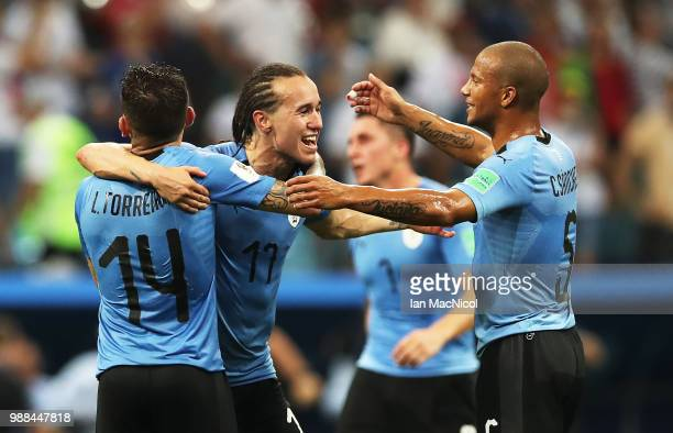 Diego Laxalt of Uruguay celebrates with team mates at full time during the 2018 FIFA World Cup Russia Round of 16 match between Uruguay and Portugal...