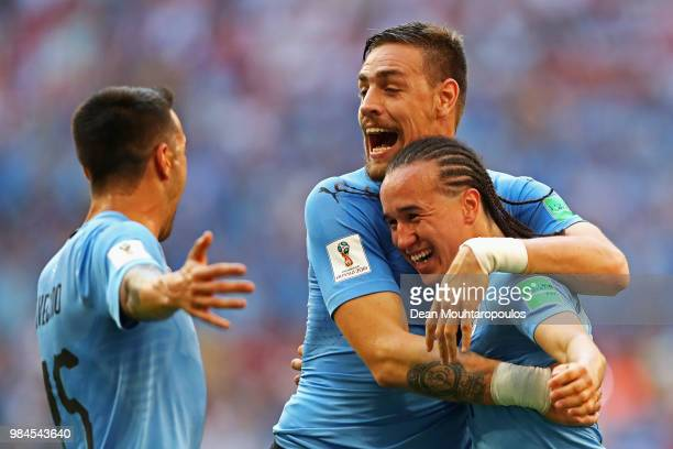 Diego Laxalt of Uruguay celebrates with teammate Sebastian Coates and Matías Vecino after scoring his team's second goal during the 2018 FIFA World...