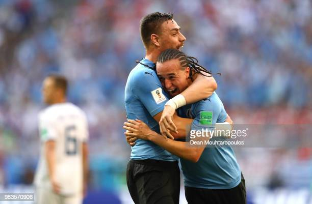 Diego Laxalt of Uruguay celebrates with teammate Sebastian Coates after scoring his team's second goal during the 2018 FIFA World Cup Russia group A...