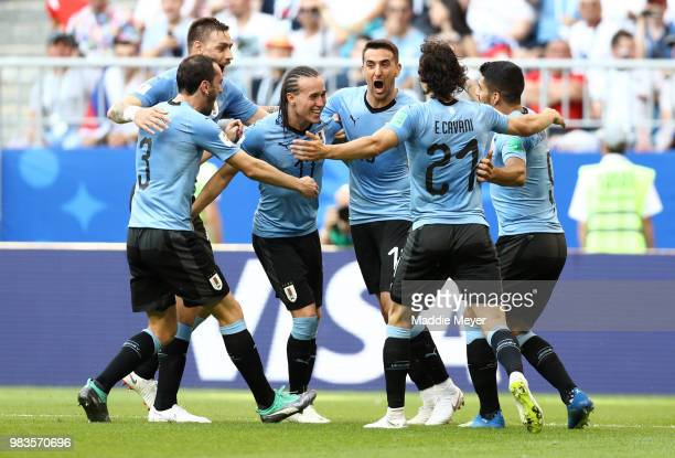 Diego Laxalt of Uruguay celebrates with teammates after scoring his team's second goal during the 2018 FIFA World Cup Russia group A match between...
