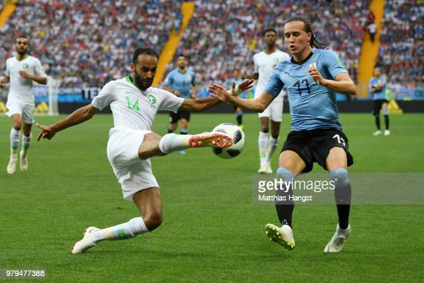 Diego Laxalt of Uruguay challenges Abdullah Otayf of Saudi Arabia during the 2018 FIFA World Cup Russia group A match between Uruguay and Saudi...