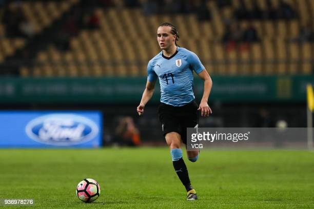Diego Laxalt of Uruguay drives the ball during the 2018 China Cup International Football Championship match between Uruguay and Czech Republic at...